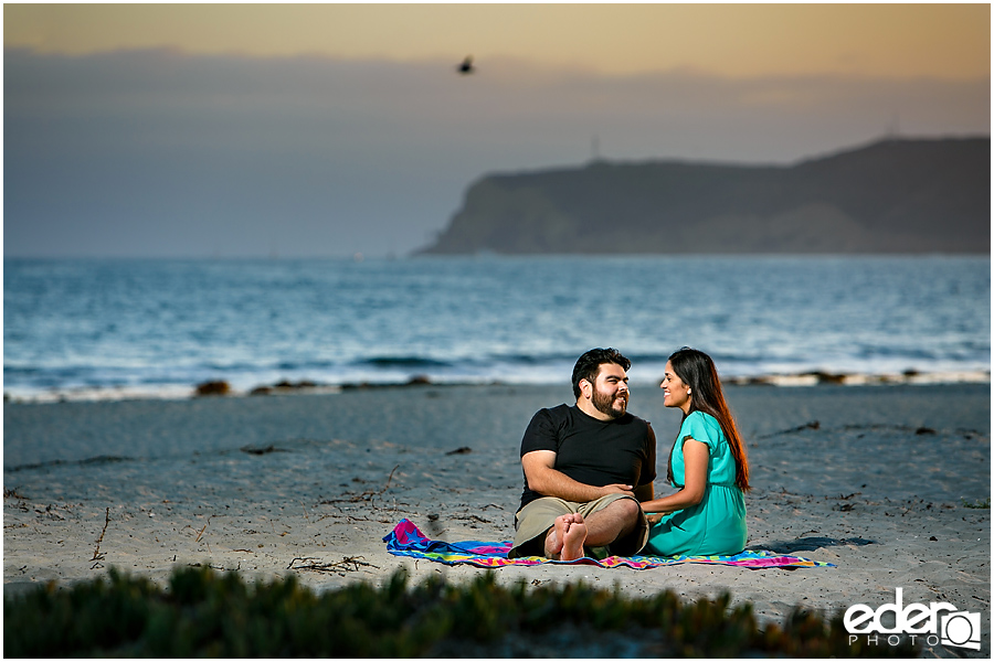 Coronado Beach engagement session with view of Cabrillo
