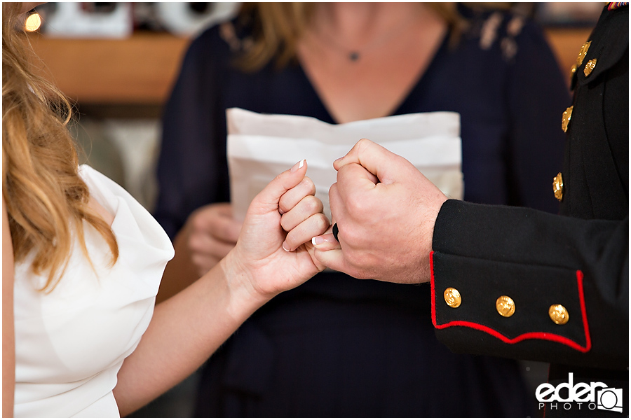 Pinky promise during a wedding ceremony