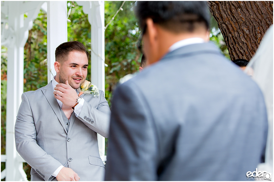 Groom crying during ceremony at Green Gables Wedding Estate