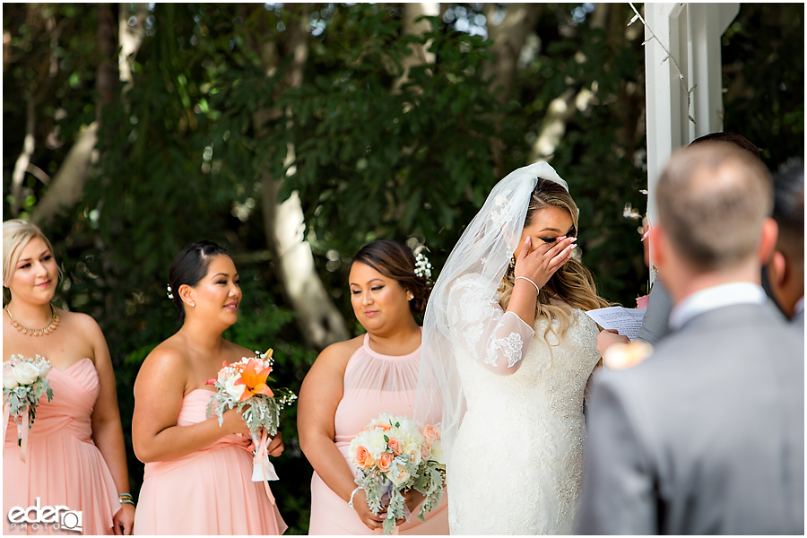 Bride crying during ceremony at Green Gables Wedding Estate