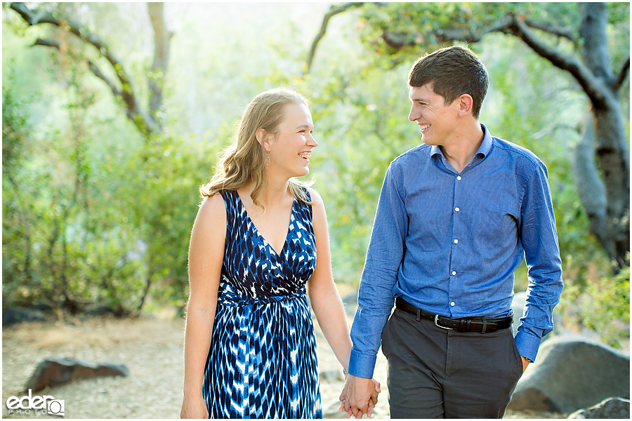 Mission Trails Engagement Session walking under trees.