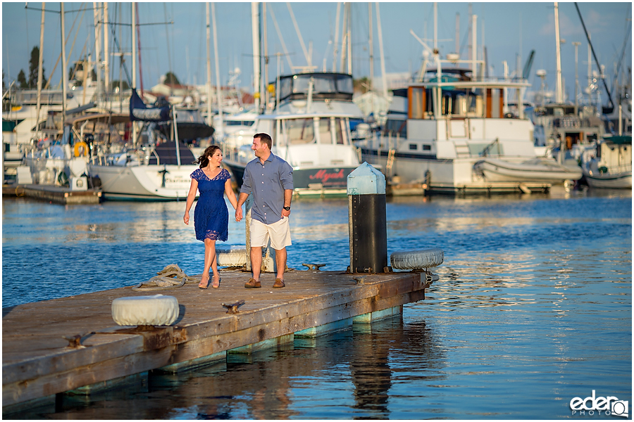 Walking on a dock during a Point Loma engagement session.