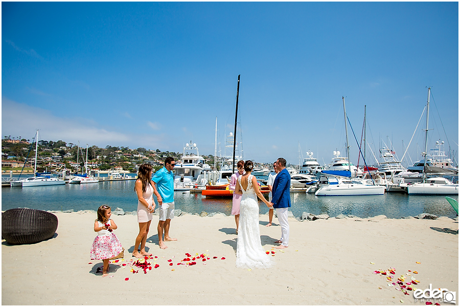 Ceremony during beach elopement at the Kona Kai Resort in San Diego, CA.