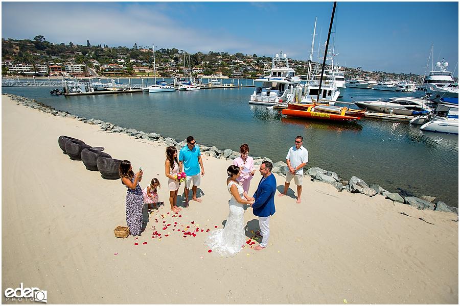 Barefoot wedding ceremony during beach elopement at the Kona Kai Resort in San Diego, CA.