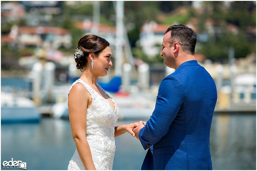 Rings exchanged during beach elopement at the Kona Kai Resort in San Diego, CA.