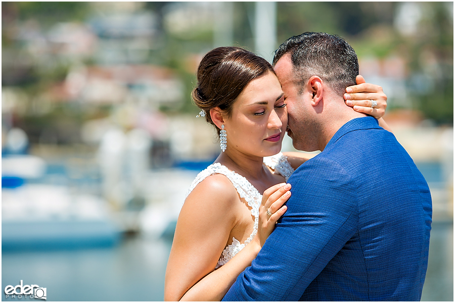 Bride and groom during beach elopement at the Kona Kai Resort in San Diego, CA.