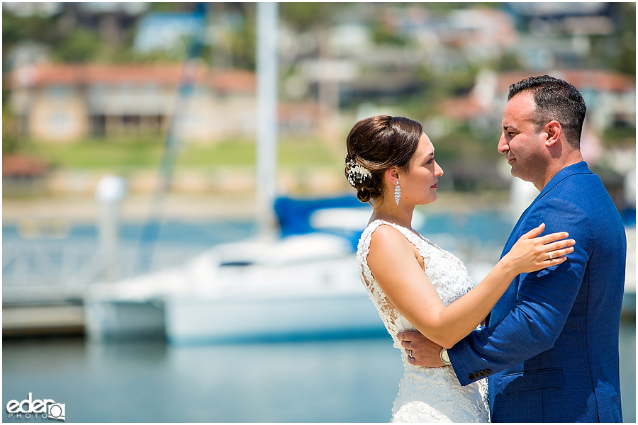 Couple looking in to each others eyes during beach elopement at the Kona Kai Resort in San Diego, CA.