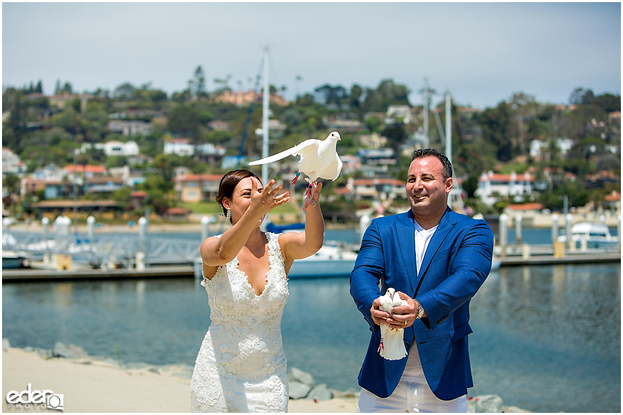 Doves being released during San Diego beach elopement.