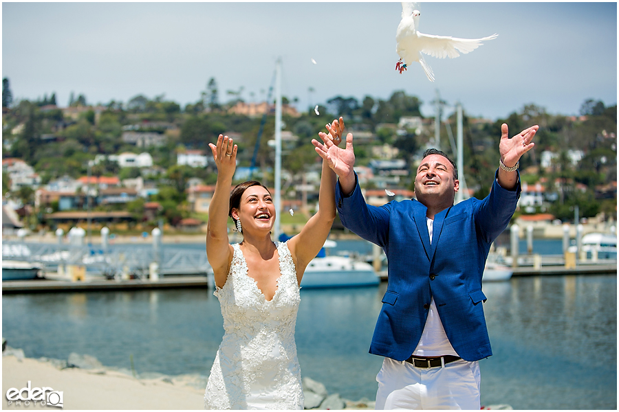 Doves being released during ceremony on the beach.