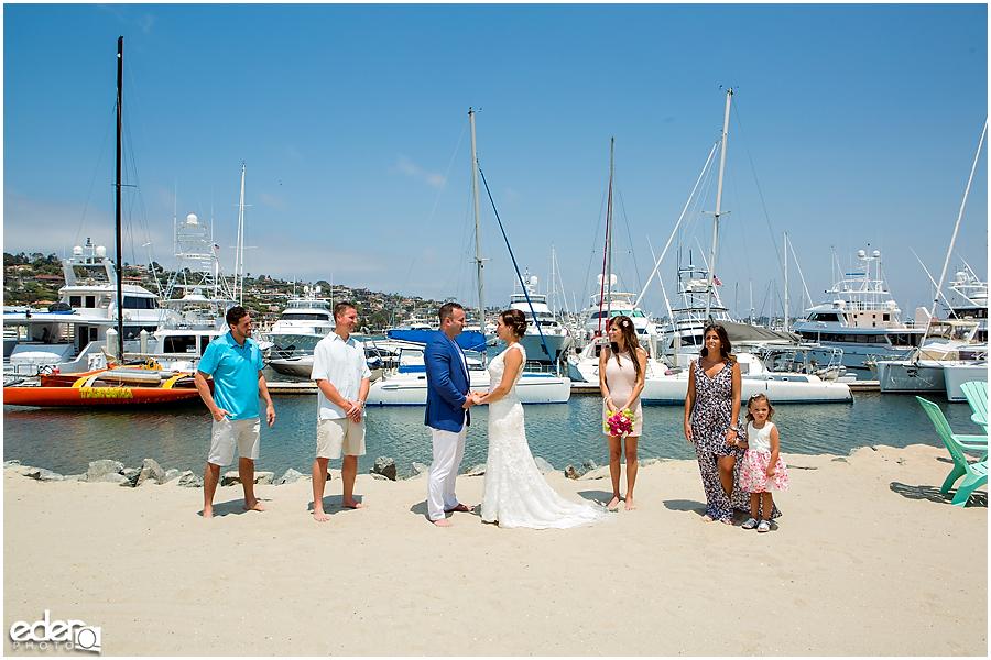 Photos on the marina during beach elopement at the Kona Kai Resort in San Diego, CA.