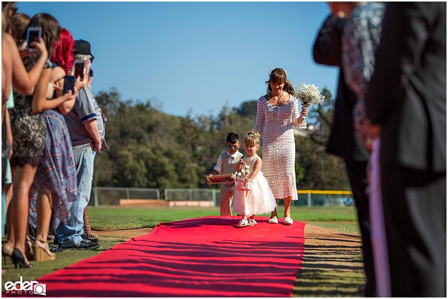 Flower girl at baseball themed wedding ceremony.