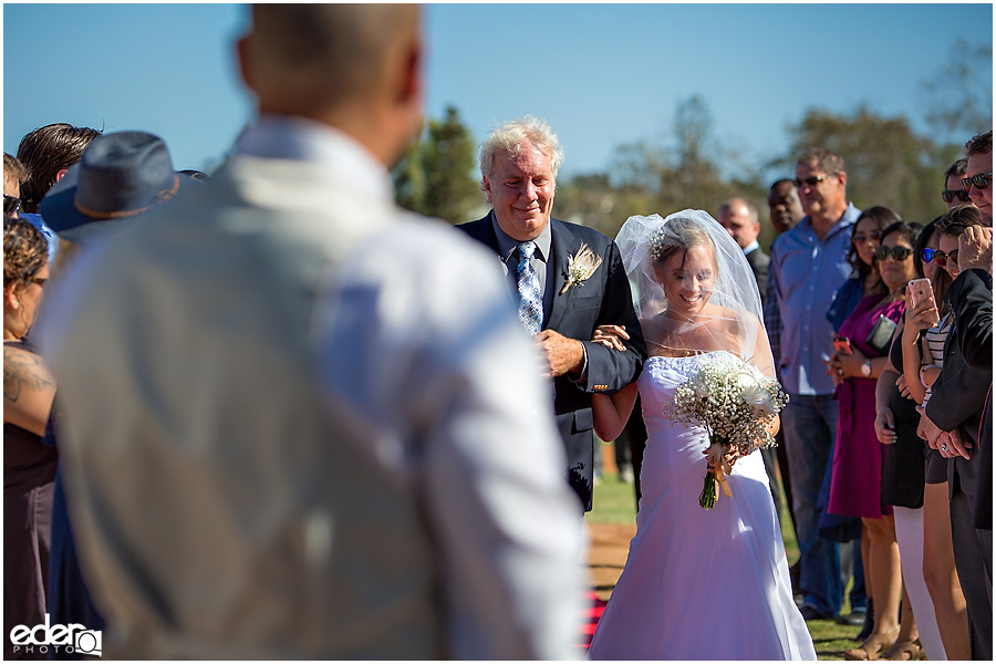 Bride and dad at baseball themed wedding ceremony.