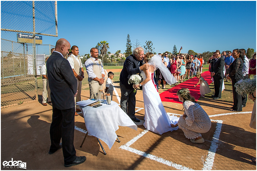 Bride and dad baseball themed wedding ceremony.