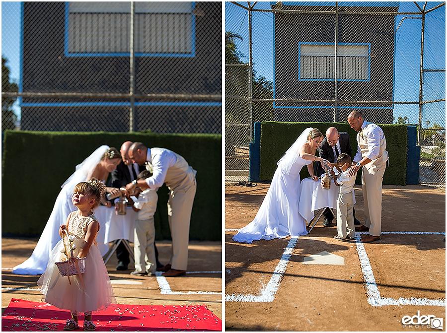Sand ceremony baseball themed wedding ceremony.