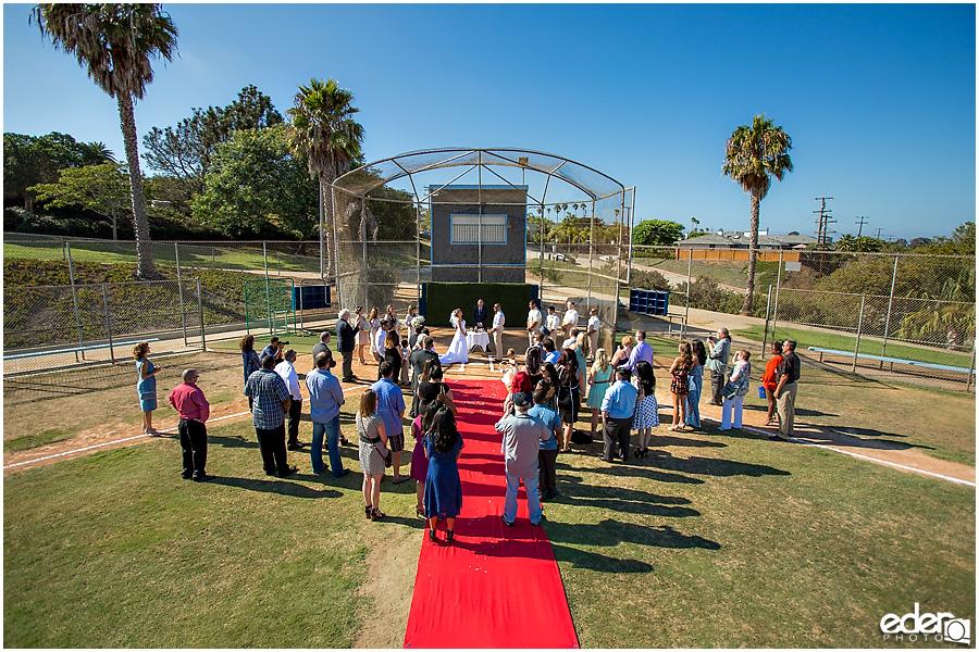 Little league field for baseball themed wedding ceremony.