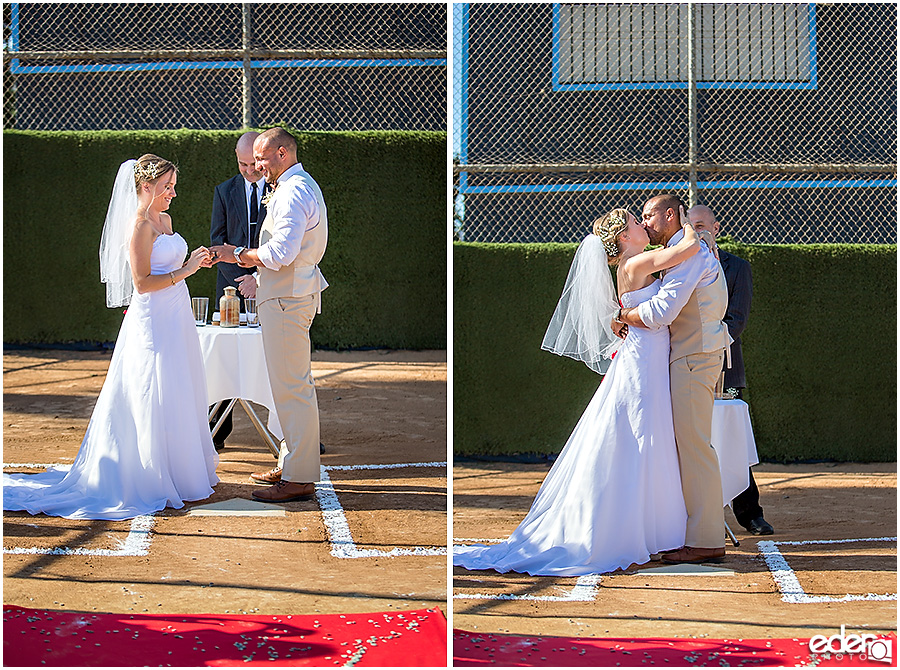 First kiss during baseball themed wedding ceremony.