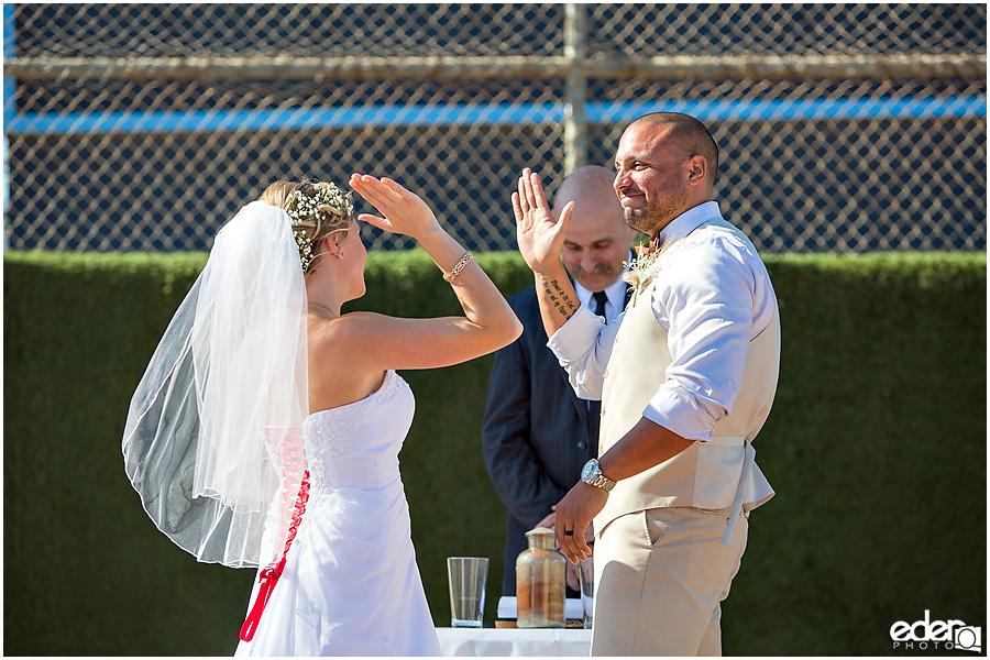 Celebration during baseball themed wedding ceremony.
