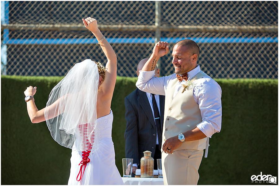 Celebration after baseball themed wedding ceremony.