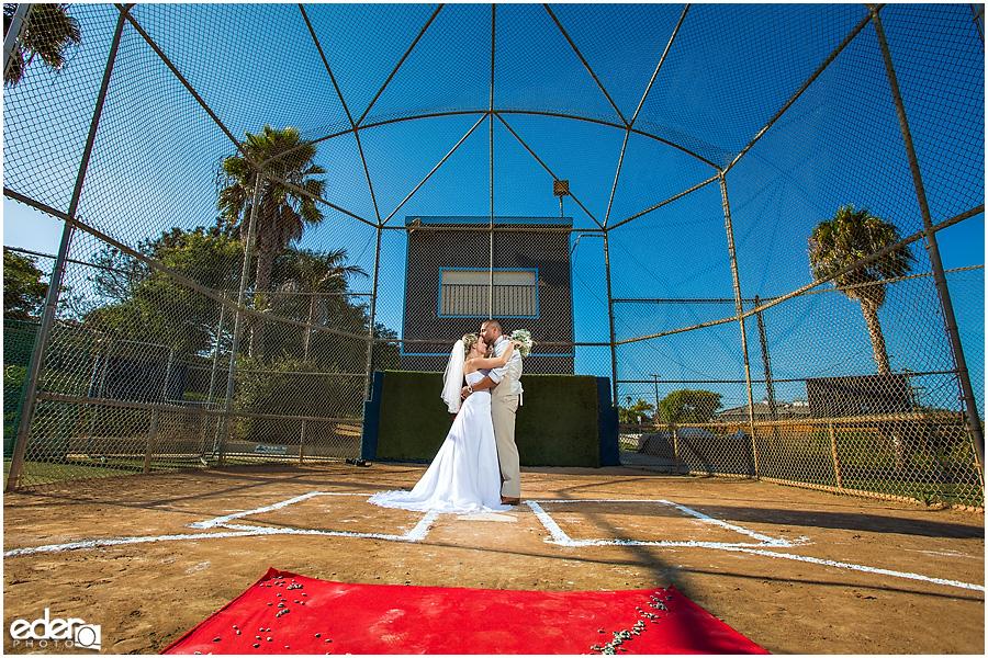Bride and groom on baseball diamond during baseball themed wedding ceremony.