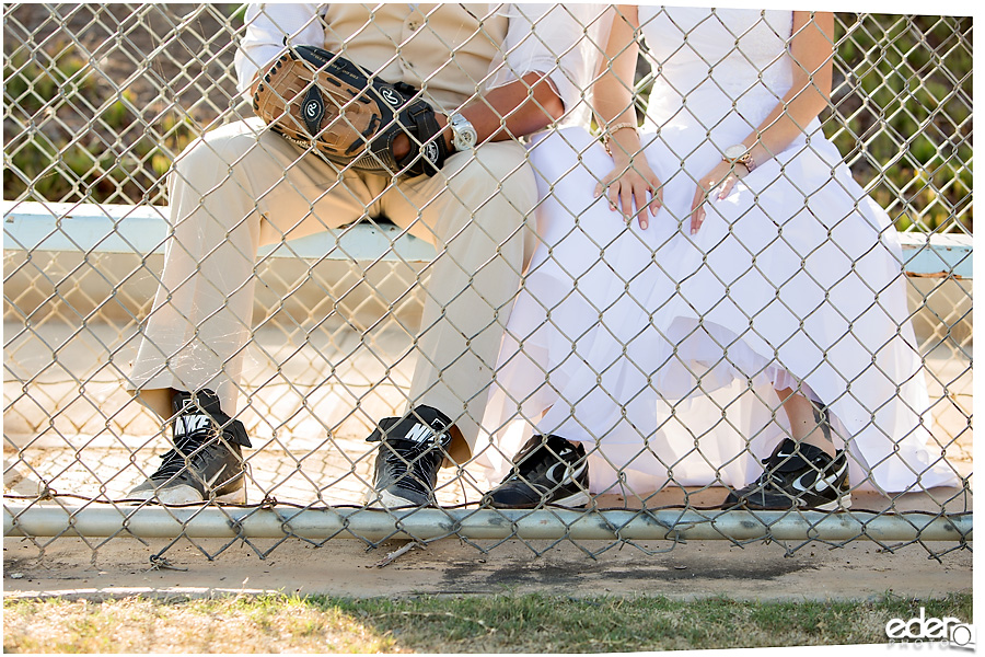 Bride and groom wearing baseball cleats.
