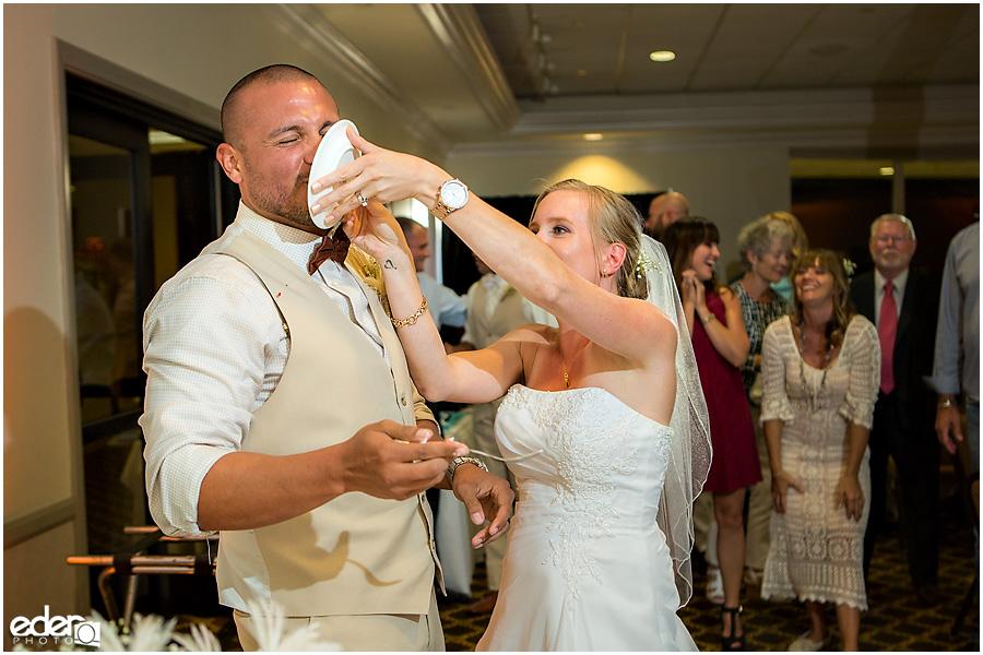 Wedding cake being smashed.