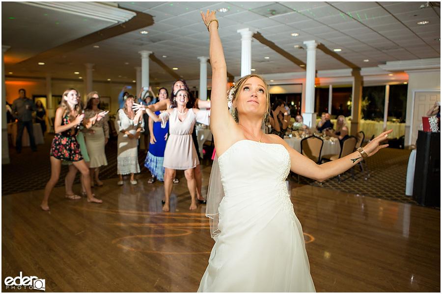 Bouquet toss at Admiral Kidd Club Wedding.