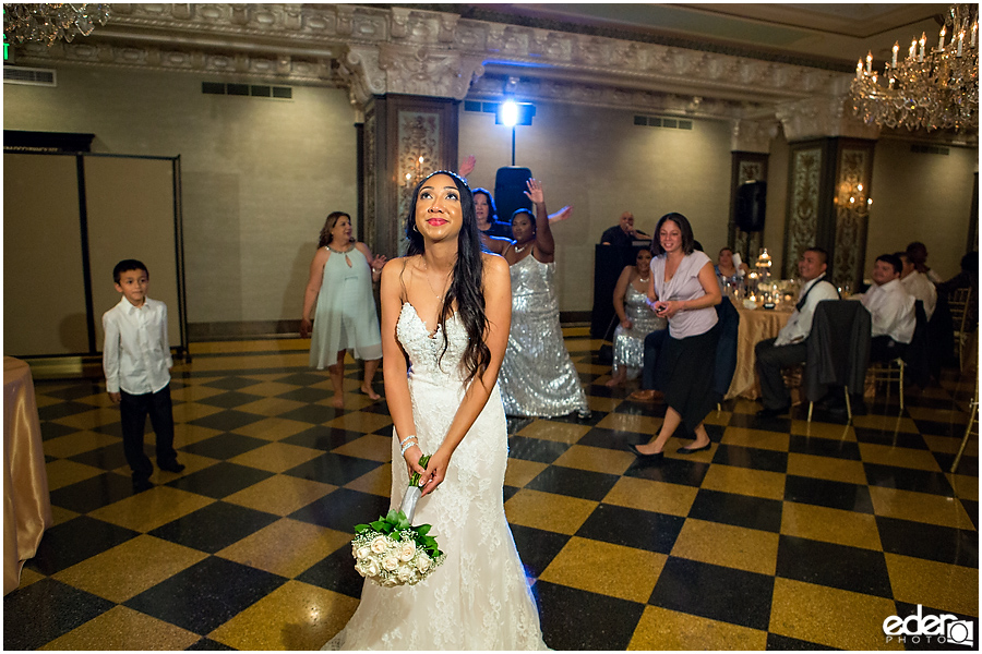 Bouquet toss at Crystal Ballroom Wedding Reception