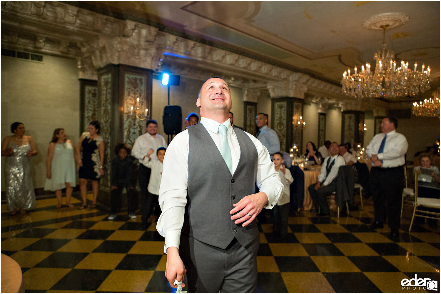 Garter toss at Crystal Ballroom Wedding Reception