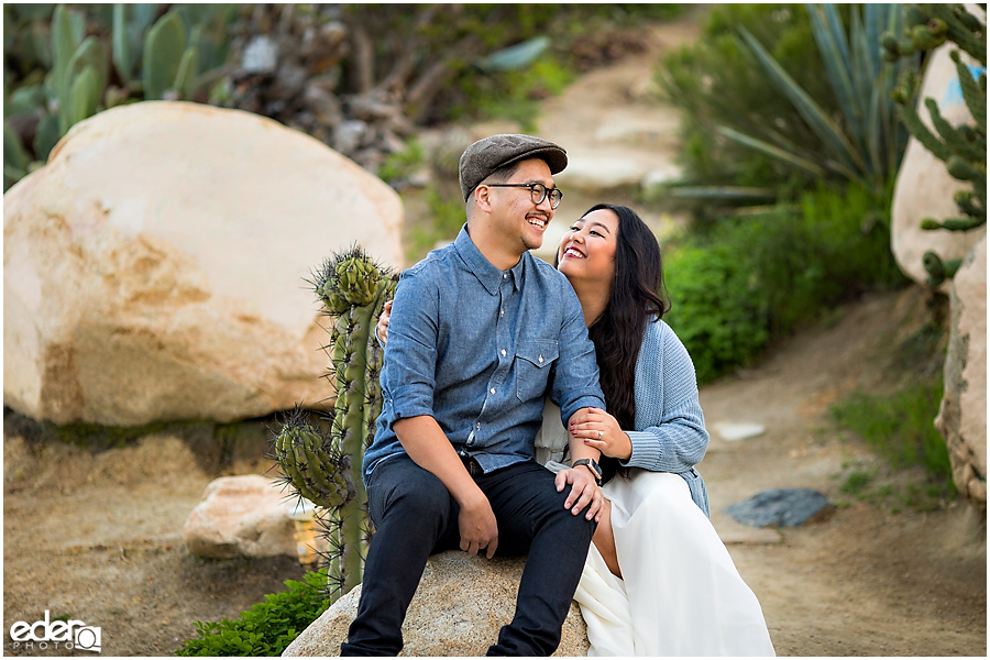 Balboa Park Engagement Session sitting in Cactus Garden.