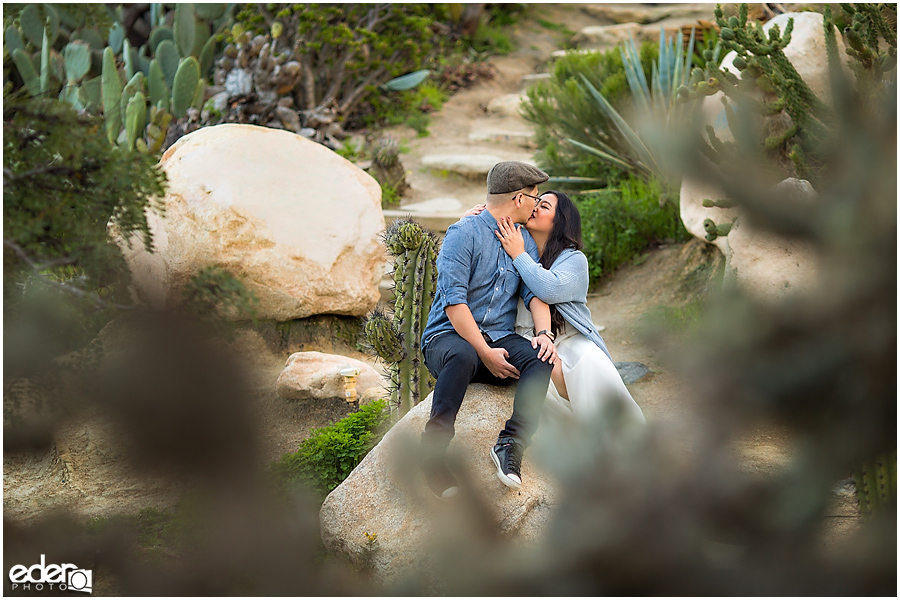 Balboa Park Engagement Session kissing in Cactus Garden.