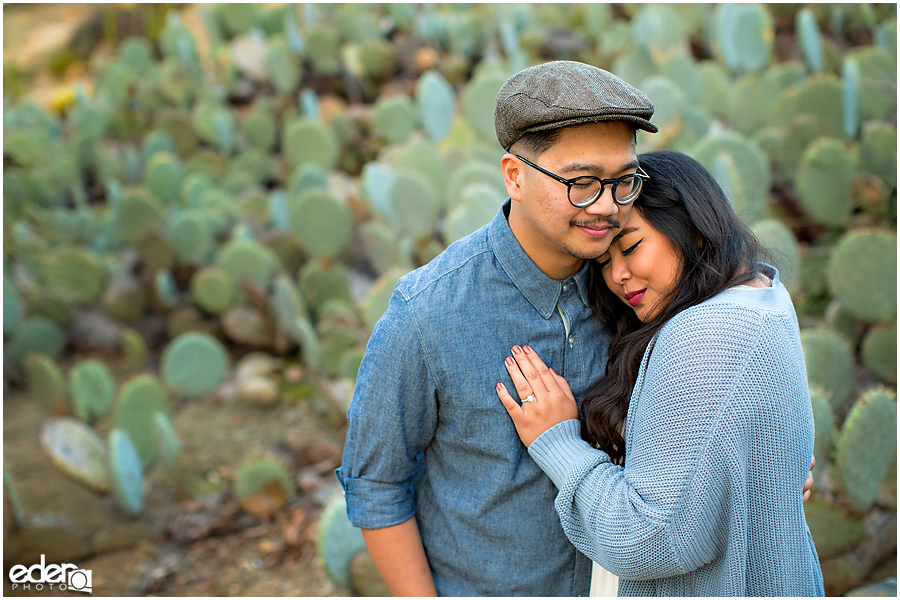 Balboa Park Engagement Session embracing in Cactus Garden.