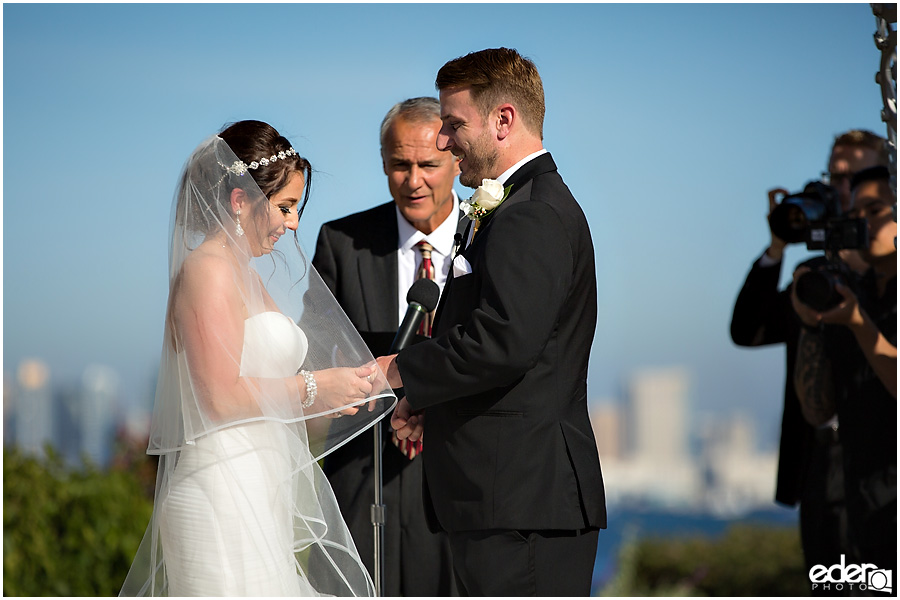 Ring exchange during ceremony at Tom Ham's Lighthouse