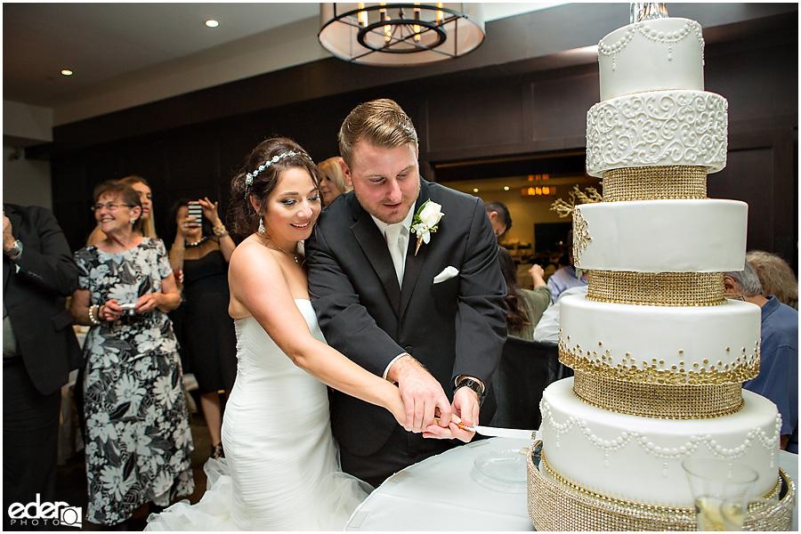 Cake cutting for Tom Ham's Lighthouse Wedding Photography