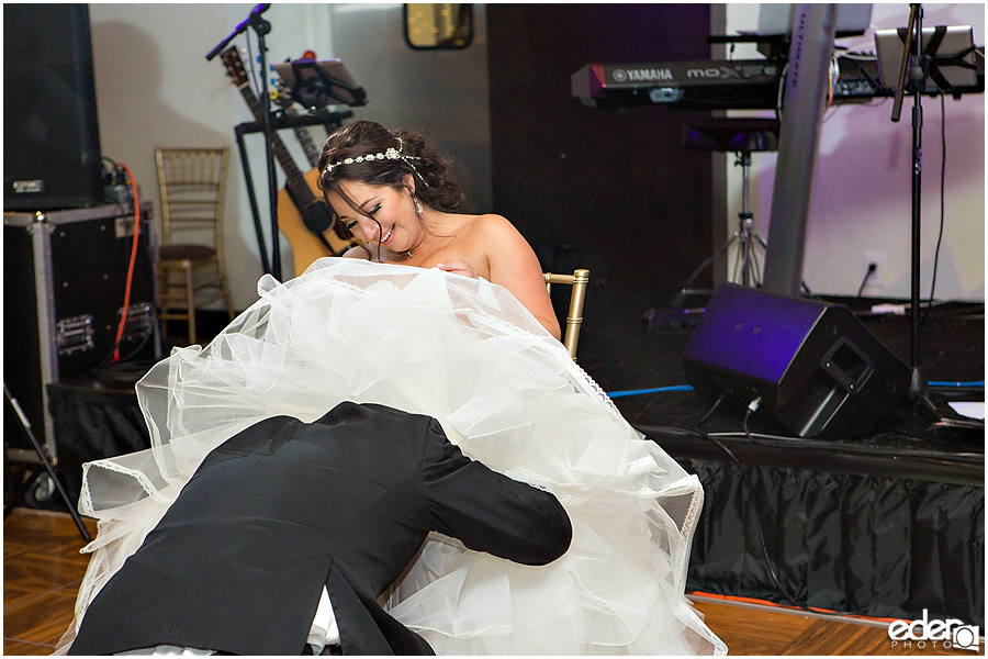 Garter toss for Tom Ham's Lighthouse Wedding Photography