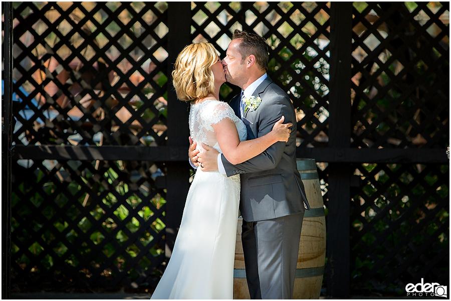 Rancho Bernardo Winery Wedding Wedding Ceremony first kiss