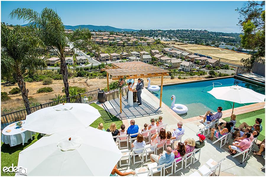 Pool wedding ceremony overhead shot.