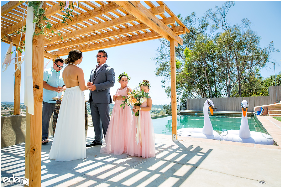 Pool wedding ceremony ring exchange.