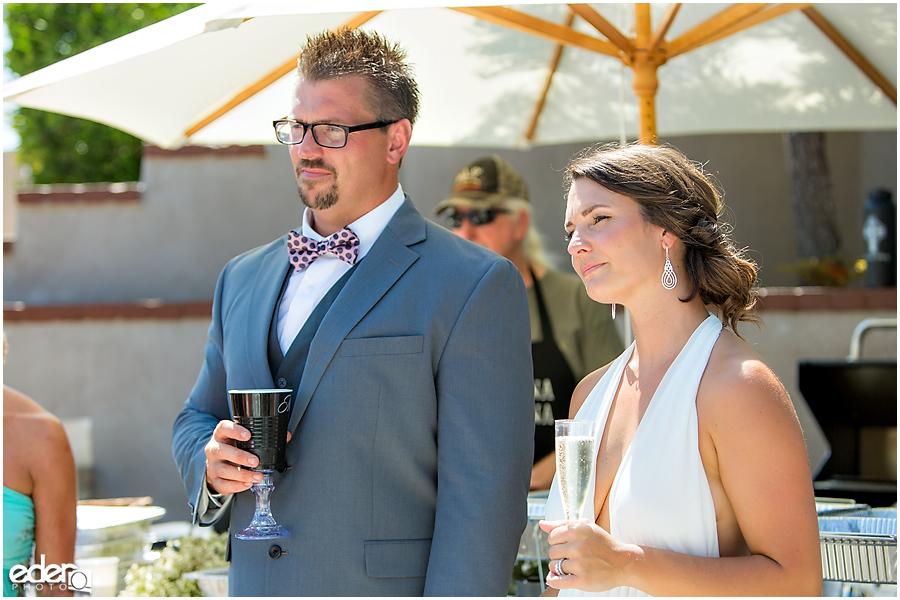 Pool wedding reception toasts.