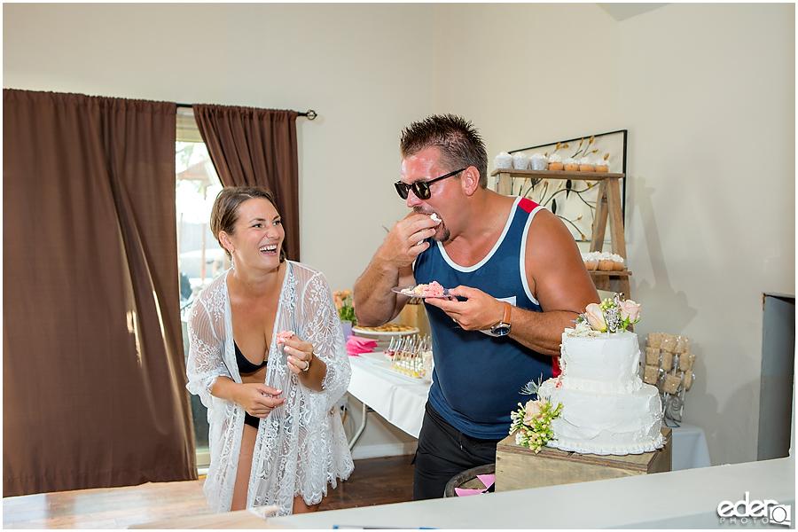 Pool wedding reception cake cutting.