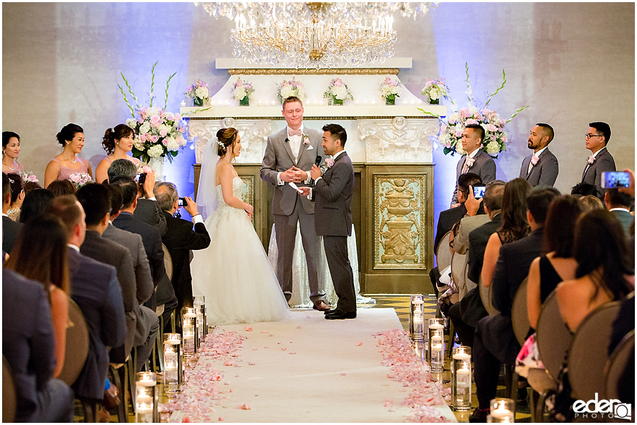 Wedding at The US Grant - photo of vow exchange in Crystal Ballroom.