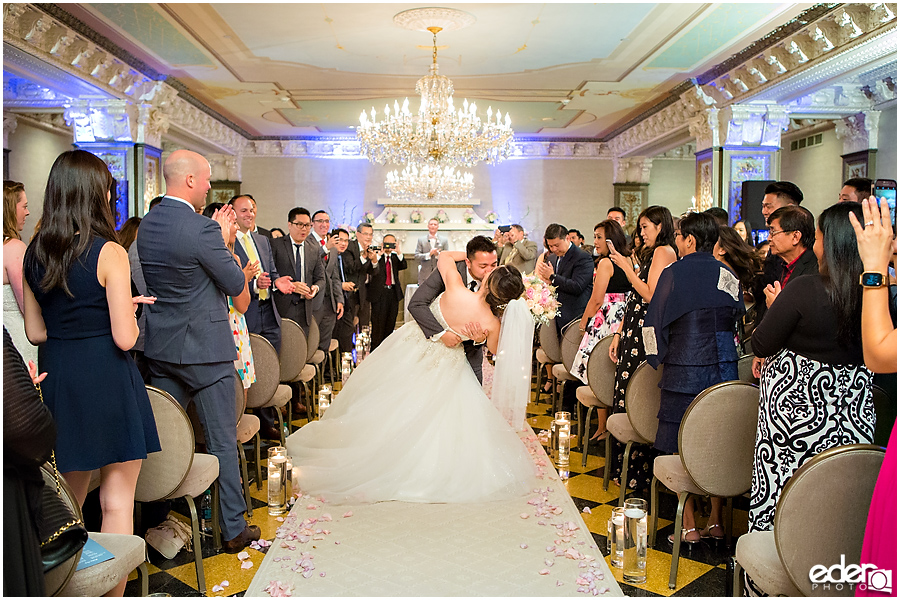 Wedding at The US Grant - photo of kiss in aisle.