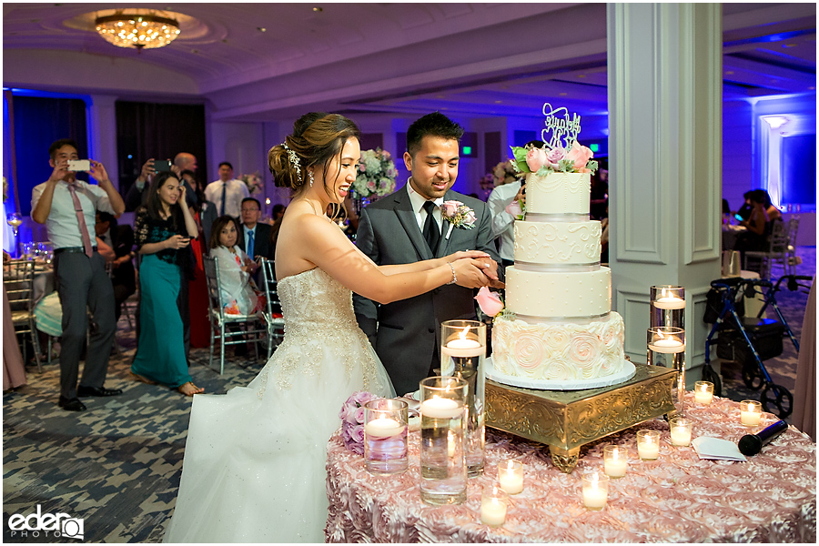Wedding at The US Grant - photo of couple cutting the cake.