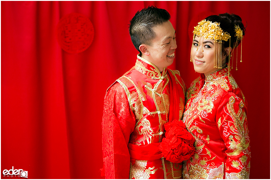 Chinese wedding bride and groom on red backdrop