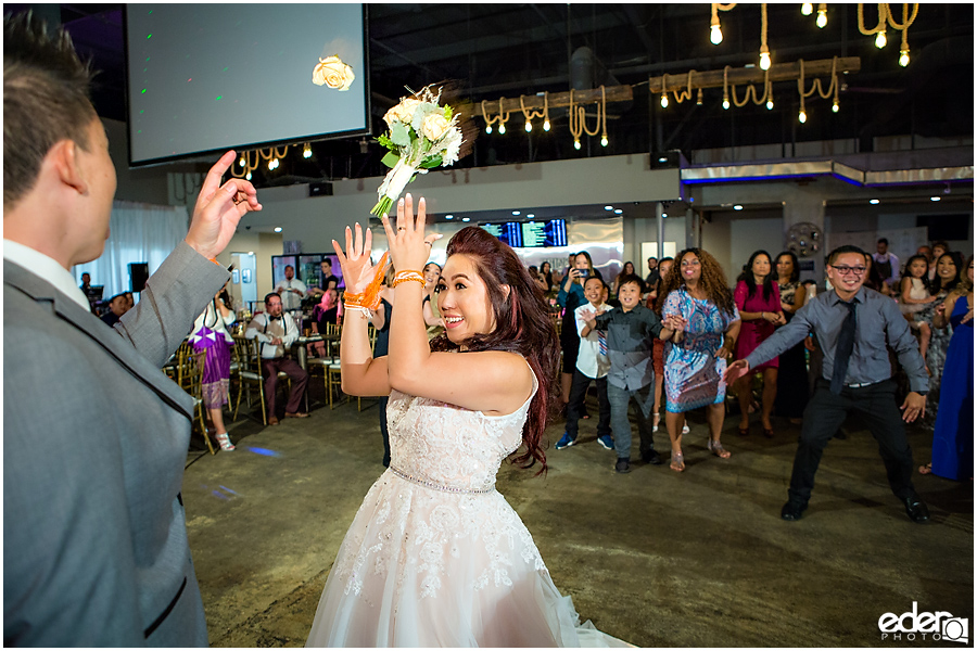 Bouquet toss photo at wedding reception at HIVE in San Diego.
