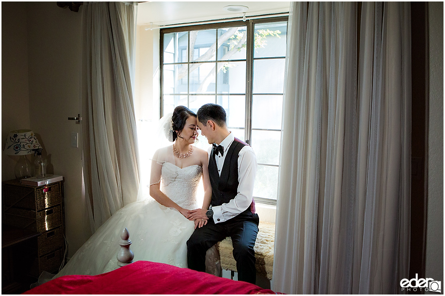 Small Winter Wedding La Jolla - bride and groom window portraits