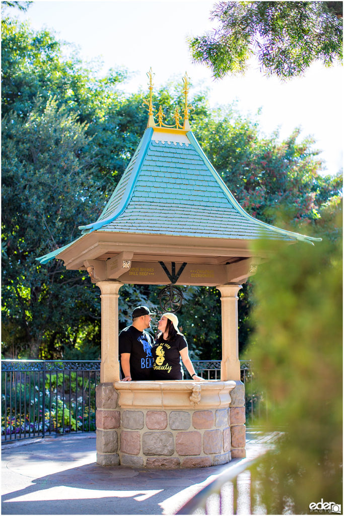 Disneyland Engagement Session next to wishing well.