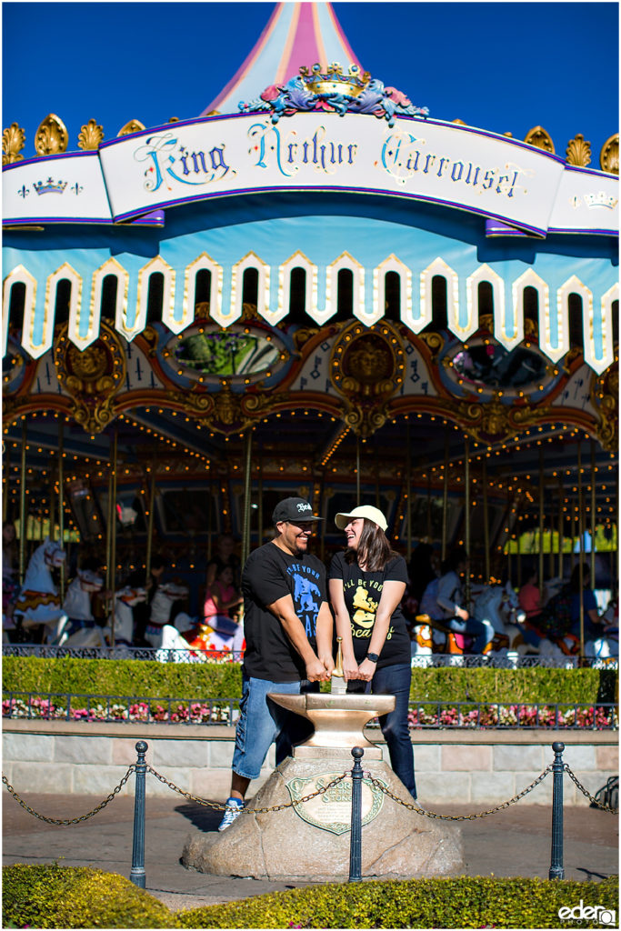 Disneyland Engagement Session in front of carousel.
