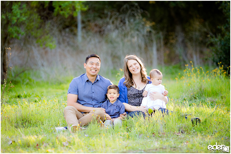 Spring Mini Portrait Session - family sitting in field